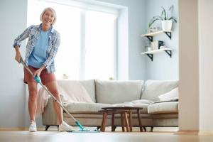 cheerful-woman-washing-floor-at-home
